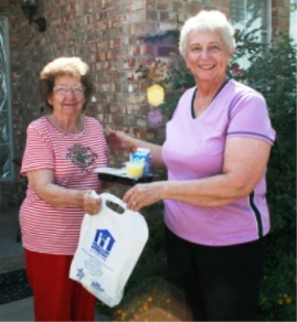 Meals On Wheels volunteer and client